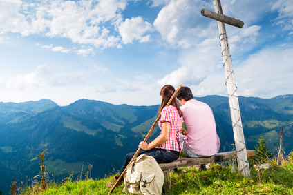 Alps - Hiking Couple takes break in mountains
